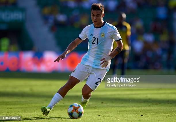 Paulo Dybala of Argentina runs with the ball during the international friendly match between Ecuador and Argentina at Estadio Manuel Martinez Valero...