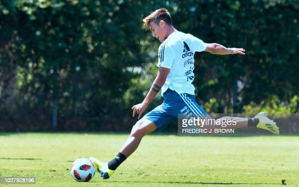 Paulo Dybala of Argentina shoots the ball during a training session in Carson California on September 6 ahead of the international soccer friendly...