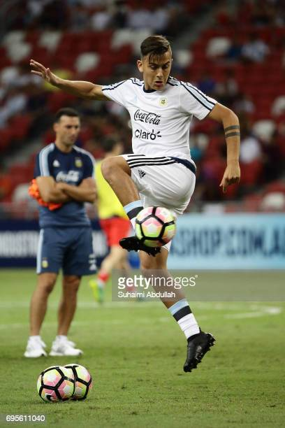 Paulo Dybala of Argentina warms up before the International Test match between Argentina and Singapore at National Stadium on June 13 2017 in...