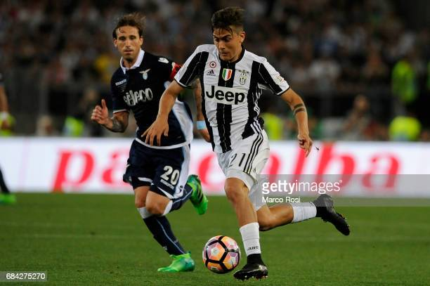 Paulo Dybala of FC Juventus compete for the ball with Lucas Biglia of SS Lazio during the TIM Cup Final match between SS Lazio and Juventus FC at...