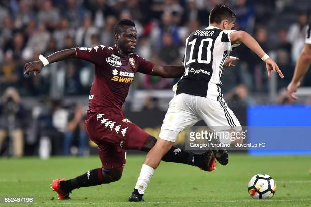 Paulo Dybala of Juventus and Afriyie Acquah of Torino during the Serie A match between Juventus and Torino FC on September 23 2017 in Turin Italy