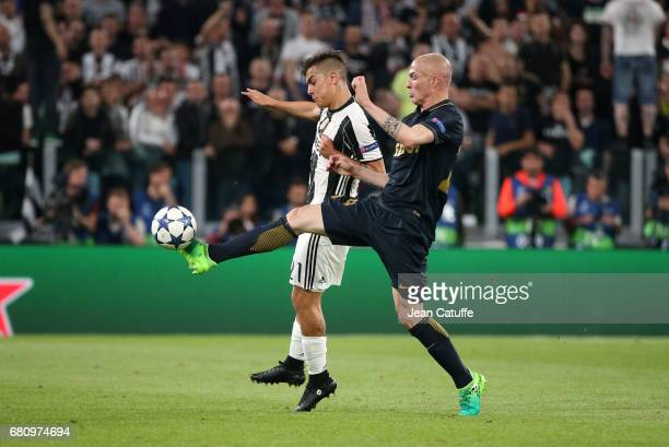 Paulo Dybala of Juventus and Andrea Raggi of Monaco in action during the UEFA Champions League semi final second leg match between Juventus Turin and...