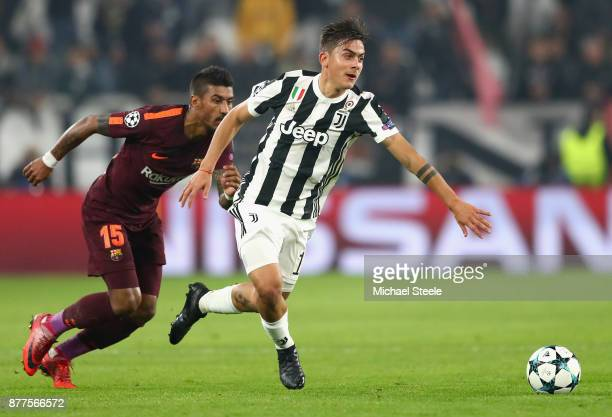 Paulo Dybala of Juventus and Lionel Messi of Barcelona battle for possession during the UEFA Champions League group D match between Juventus and FC...