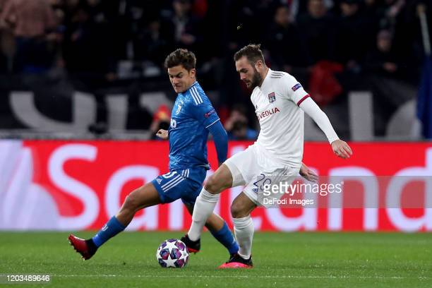 Paulo Dybala of Juventus and Lucas Tousart of Olympique Lyon battle for the ball during the UEFA Champions League round of 16 first leg match between...