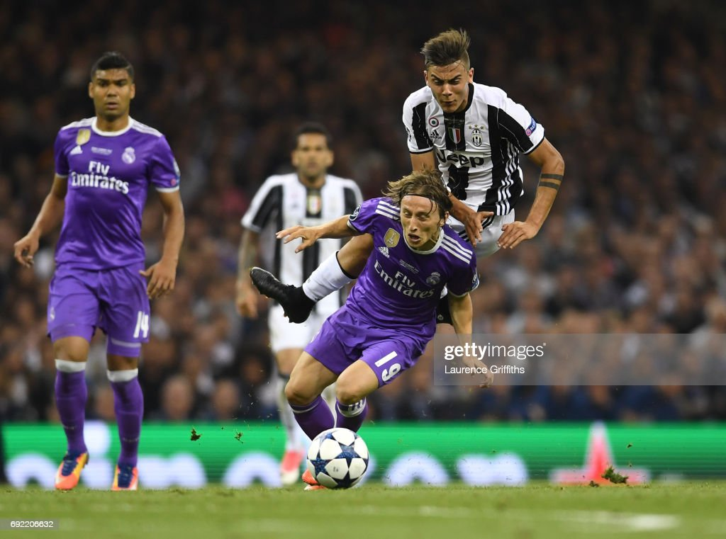 Paulo Dybala of Juventus and Luka Modric of Real Madrid battle for possession during the UEFA Champions League Final between Juventus and Real Madrid at National Stadium of Wales on June 3, 2017 in Cardiff, Wales.