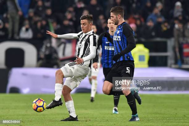 Paulo Dybala of Juventus and Roberto Gagliardini of FC Internazionale compete for the ball during the Serie A match between Juventus and FC...