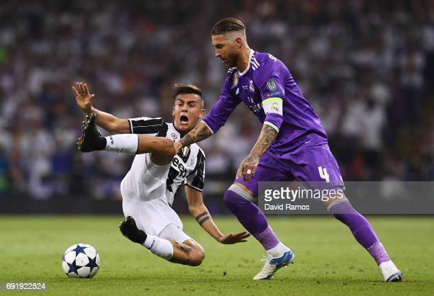 Paulo Dybala of Juventus and Sergio Ramos of Real Madrid battle for possession during the UEFA Champions League Final between Juventus and Real...