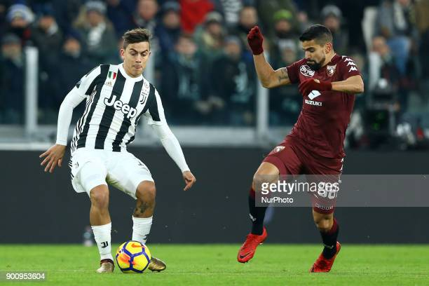 Paulo Dybala of Juventus and Tomas Rincon of Torino during the TIM Cup match between Juventus and Torino FC at Allianz Stadium on January 3 2018
