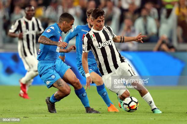 Paulo Dybala of Juventus battles for the ball with Allan of SSC Napoli during the serie A match between Juventus and SSC Napoli on April 22 2018 in...