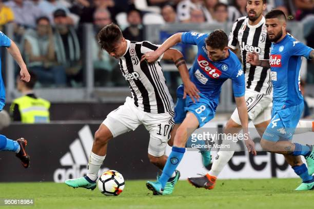Paulo Dybala of Juventus battles for the ball with Jorginho of SSC Napoli during the serie A match between Juventus and SSC Napoli on April 22 2018...