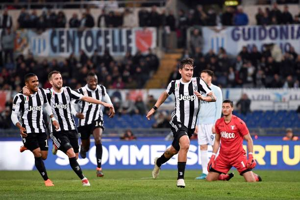 Paulo Dybala of Juventus celebrates 0-1 goal during the serie A match between SS Lazio and Juventus at Stadio Olimpico on March 3, 2018 in Rome,...