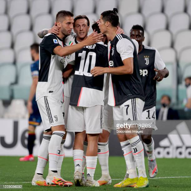Paulo Dybala of Juventus celebrates 1-0 with Rodrigo Bentancur of Juventus, Federico Bernardeschi of Juventus, Cristiano Ronaldo of Juventus during...