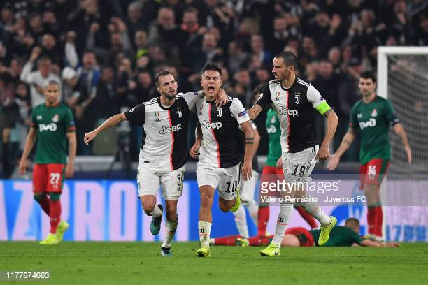 Paulo Dybala of Juventus celebrates after his goal with teammates Miralem Pjanic and Leonardo Bonucci during the UEFA Champions League group D match...
