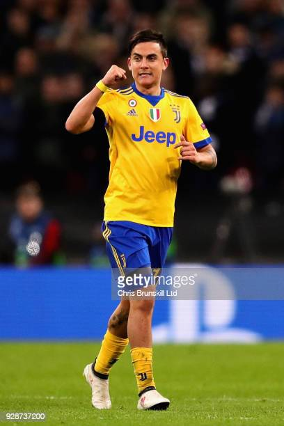 Paulo Dybala of Juventus celebrates after scoring his sides second goal during the UEFA Champions League Round of 16 Second Leg match between...
