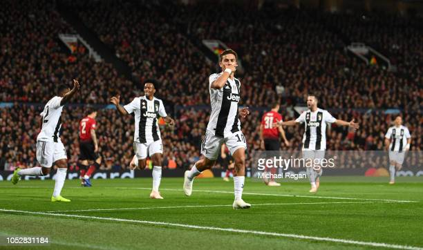 Paulo Dybala of Juventus celebrates after scoring his team's first goal during the Group H match of the UEFA Champions League between Manchester...