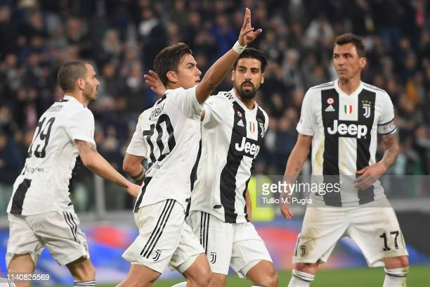 Paulo Dybala of Juventus celebrates after scoring the equalizing goal during the Serie A match between Juventus and AC Milan on April 06 2019 in...