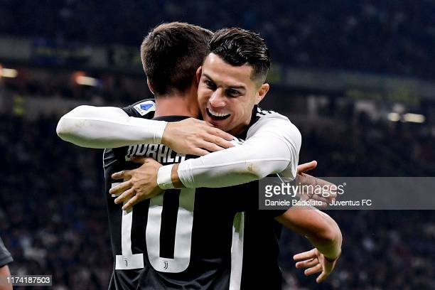 Paulo Dybala of Juventus celebrates after scoring the opening goal with teammate Cristiano Ronaldo during the Serie A match between FC Internazionale...
