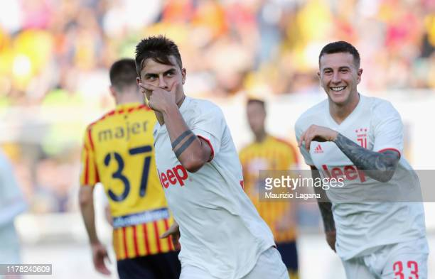 Paulo Dybala of Juventus celebrates after scoring the opening goal from the penalty spot during the Serie A match between US Lecce and Juventus at...