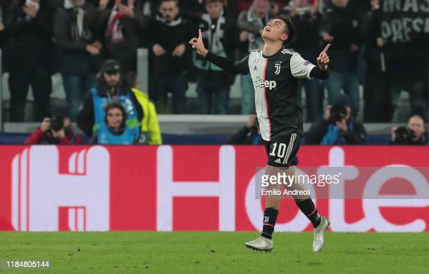 Paulo Dybala of Juventus celebrates after scoring the opening goal during the UEFA Champions League group D match between Juventus and Atletico...