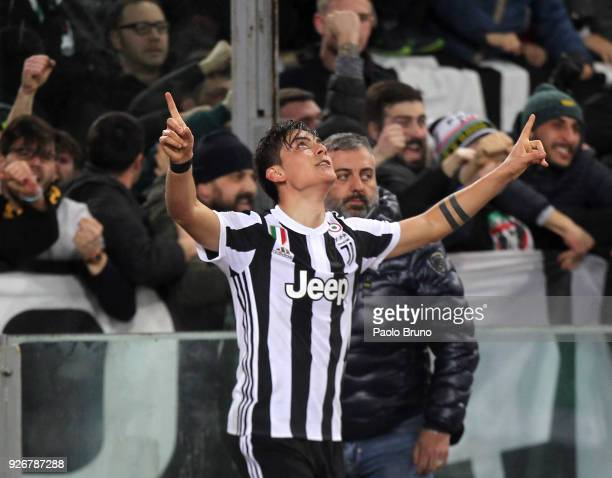Paulo Dybala of Juventus celebrates after scoring the opening goal during the serie A match between SS Lazio and Juventus at Stadio Olimpico on March...