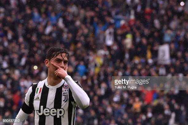 Paulo Dybala of Juventus celebrates after scoring the opening goal during the serie A match between Juventus and Udinese Calcio on March 11 2018 in...