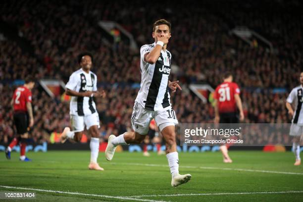 Paulo Dybala of Juventus celebrates after scoring their 1st goal during the Group H match of the UEFA Champions League between Manchester United and...