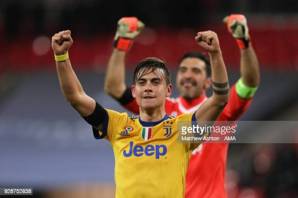 Paulo Dybala of Juventus celebrates after the 12 victory with goalkeeper Gianluigi Buffon during the UEFA Champions League Round of 16 Second Leg...