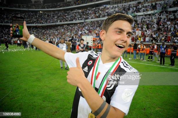 Paulo Dybala of Juventus celebrates after winning the Italian Supercup match between Juventus and AC Milan at King Abdullah Sports City on January 16...