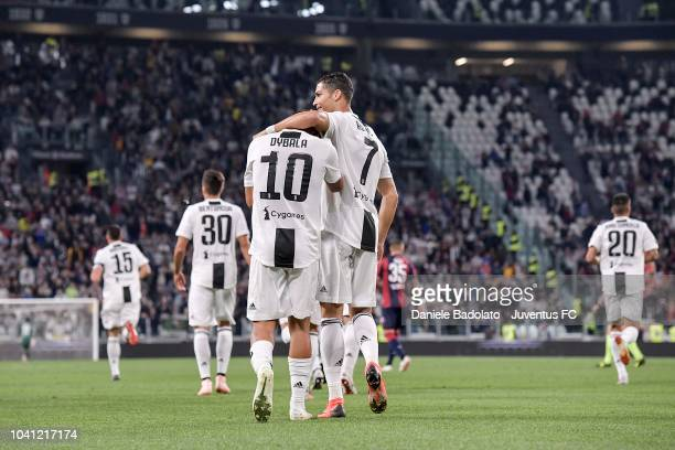 Paulo Dybala of Juventus celebrates his goal of 10 with teammate Cristiano Ronaldo during the serie A match between Juventus and Bologna FC on...