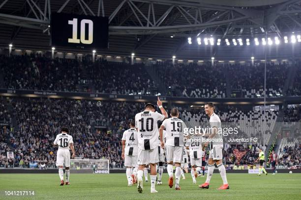 Paulo Dybala of Juventus celebrates his goal of 10 with teammates during the serie A match between Juventus and Bologna FC on September 26 2018 in...