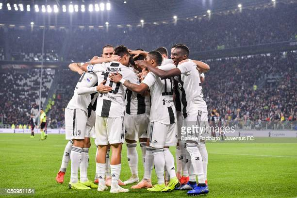 Paulo Dybala of Juventus celebrates his goal of 10 with teammates during the Serie A match between Juventus and Cagliari on November 3 2018 in Turin...