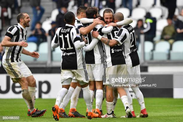 Paulo Dybala of Juventus celebrates his goal of 20 with teammates during the serie A match between Juventus and Udinese Calcio on March 11 2018 in...