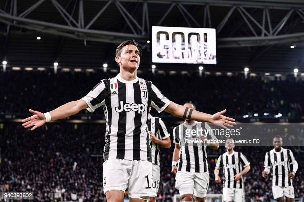 Paulo Dybala of Juventus celebrates his opening goal during the serie A match between Juventus and AC Milan at Allianz Stadium on March 31 2018 in...