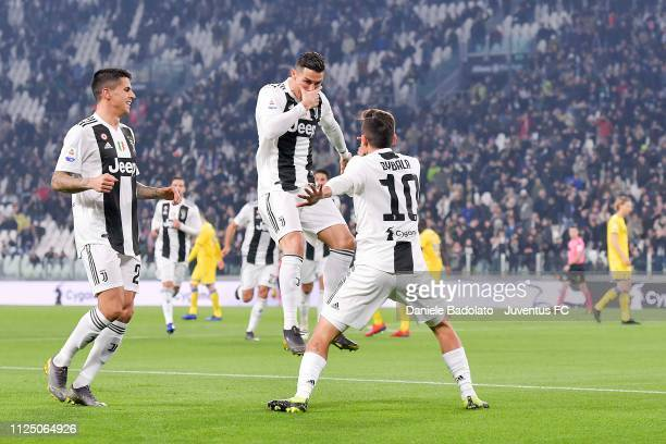 Paulo Dybala of Juventus celebrates his opening goal with teammates Cristiano Ronaldo and Joao Cancelo during the Serie A match between Juventus and...