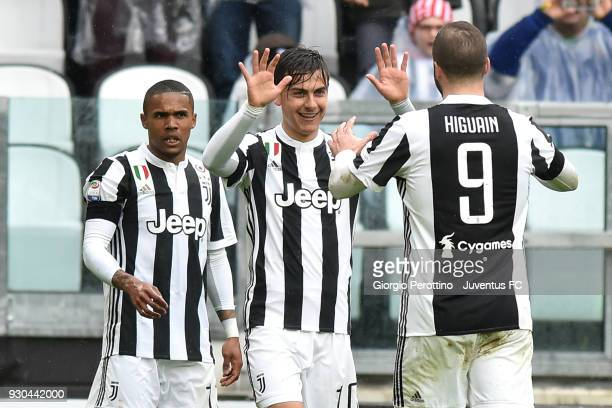 Paulo Dybala of Juventus celebrates his opening goal with teammates during the serie A match between Juventus and Udinese Calcio on March 11 2018 in...