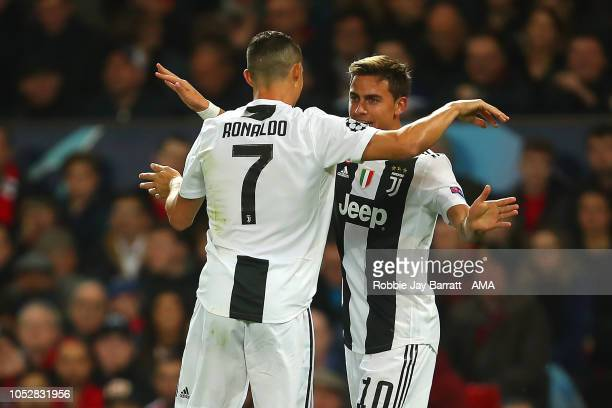 Paulo Dybala of Juventus celebrates scoring a goal to make the score 01 with Cristiano Ronaldo of Juventus during the Group H match of the UEFA...