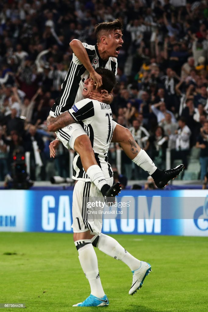 Paulo Dybala of Juventus celebrates scoring the second goal to make the score 2-0 with Mario Mandzukic during the UEFA Champions League Quarter Final first leg match between Juventus and FC Barcelona at Juventus Stadium on April 11, 2017 in Turin, Italy.