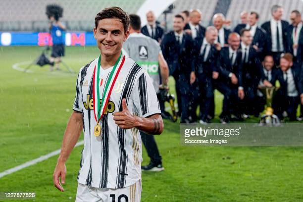 Paulo Dybala of Juventus celebrates the championship during the Italian Serie A match between Juventus v AS Roma at the Allianz Stadium on August 1...