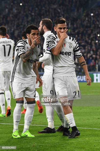 Paulo Dybala of Juventus celebrates the opening goal with team mate Daniel Alves during the UEFA Champions League Round of 16 second leg match...