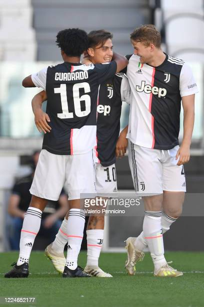 Paulo Dybala of Juventus celebrates the opening goal with team mates Juan Cuadrado and Matthijs de Ligt during the Serie A match between Juventus and...