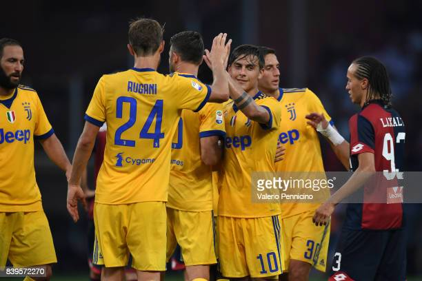 Paulo Dybala of Juventus celebrates victory with team mate Daniele Rugani during the Serie A match between Genoa CFC and Juventus at Stadio Luigi...