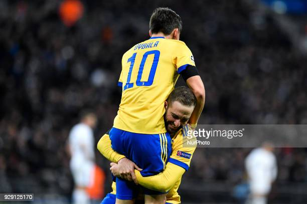 Paulo Dybala of Juventus celebrates with Gonzalo Higuain of Juventus scoring second goal during the UEFA Champions League match between Tottenham...
