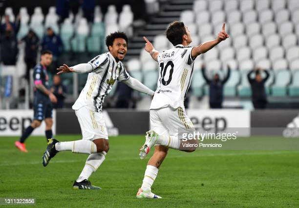 Paulo Dybala of Juventus celebrates with team mate Weston McKennie after scoring their side's second goal during the Serie A match between Juventus...
