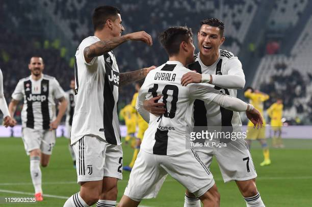 Paulo Dybala of Juventus celebrates with teammate Cristiano Ronaldo after scoring the opening goal during the Serie A match between Juventus and...