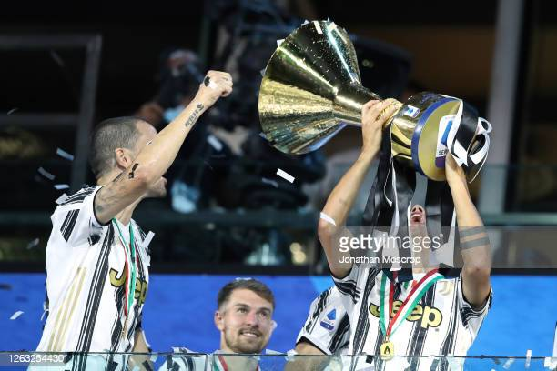 Paulo Dybala of Juventus celebrates with the scudetto following during the Serie A match between Juventus and AS Roma at on August 01 2020 in Turin...