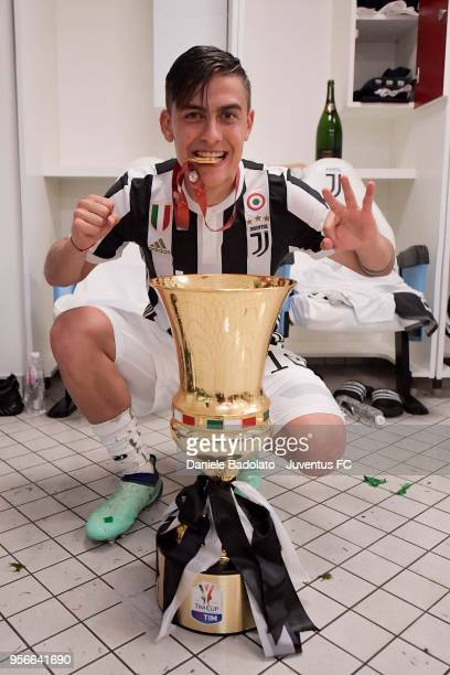 Paulo Dybala of Juventus celebrates with the trophy after winning the TIM Cup Final between Juventus and AC Milan at Stadio Olimpico on May 9 2018 in...
