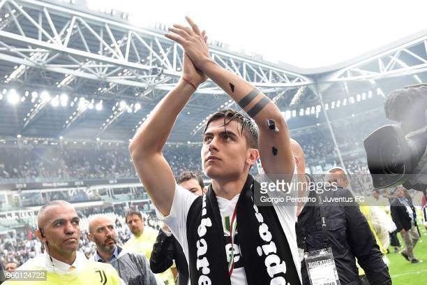 Paulo Dybala of Juventus celebrating the seventh league titles in a row after the serie A match between Juventus and Hellas Verona FC at Allianz...