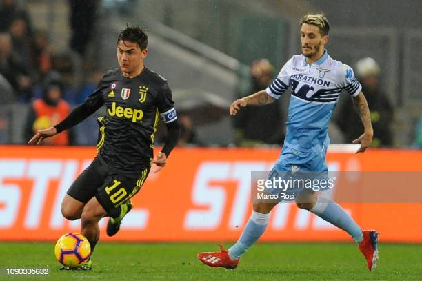 Paulo Dybala of Juventus compete for the ball with Luis Alberto of SS lazio during the Serie A match between SS Lazio and Juventus at Stadio Olimpico...