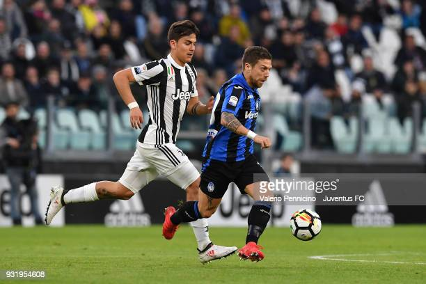 Paulo Dybala of Juventus competes for the ball with Alejandro Gomez of Atalanta BC during the serie A match between Juventus and Atalanta BC on March...