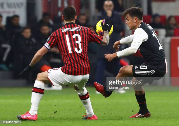 Paulo Dybala of Juventus competes for the ball with Alessio Romagnoli of AC Milan during the Coppa Italia Semi Final match between AC Milan and...